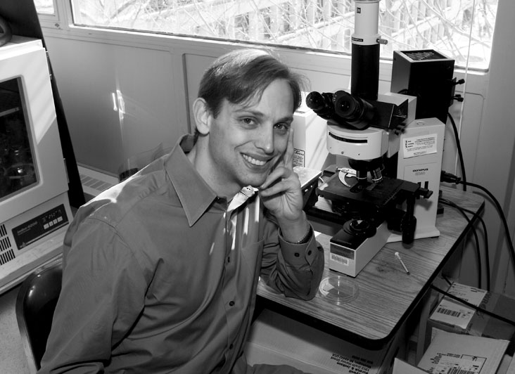 """David Berry says that it was actually MIT Prof. Robert Langer who gave him the insight to make his discoveries when he told him to think in the context of big problems. """"As I looked at my microcosm of research, I asked myself, How can I use these results to treat stroke or cancer?"""" Photo: Ed Quinn"""