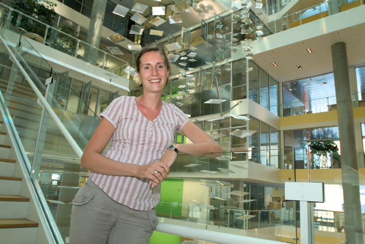 Marilyne Andersen, shown in a Genzyme facility that maximizes use of daylight in its operations, studies various ways to reduce energy use in buildings. Photo: Ed Quinn