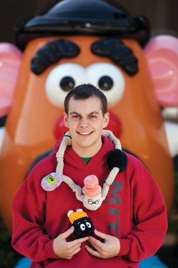 Michael Snively designed a line of stuffed toys that teach kids about circuits. Mr. Potato Head — which stands outside Hasbro in Pawtucket, R.I. — is shown in the background. Photo: Len Rubenstein