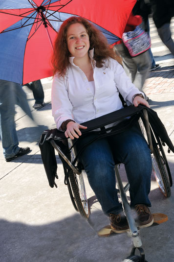 Tish Scolnik dreamed up a way to put the disabled to work. Here she demonstrates a wheelchair she designed that can double as a portable office.  Photo: Len Rubenstein
