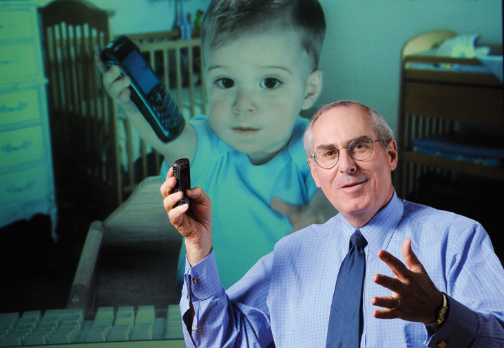 Don Layton, CEO of E*TRADE Financial, says the skills he developed at MIT were key to his success. He is shown with the E*TRADE baby, who stars in the company's TV ads.  Photo: Len Rubenstein