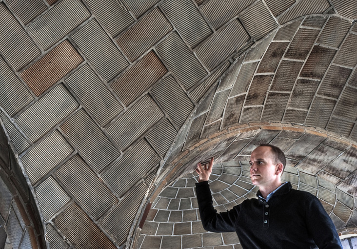 John Ochsendorf examines tile vault construction at MIT which inspired him to create a dramatically low-carbon building in South Africa. Photo: Len Rubenstein