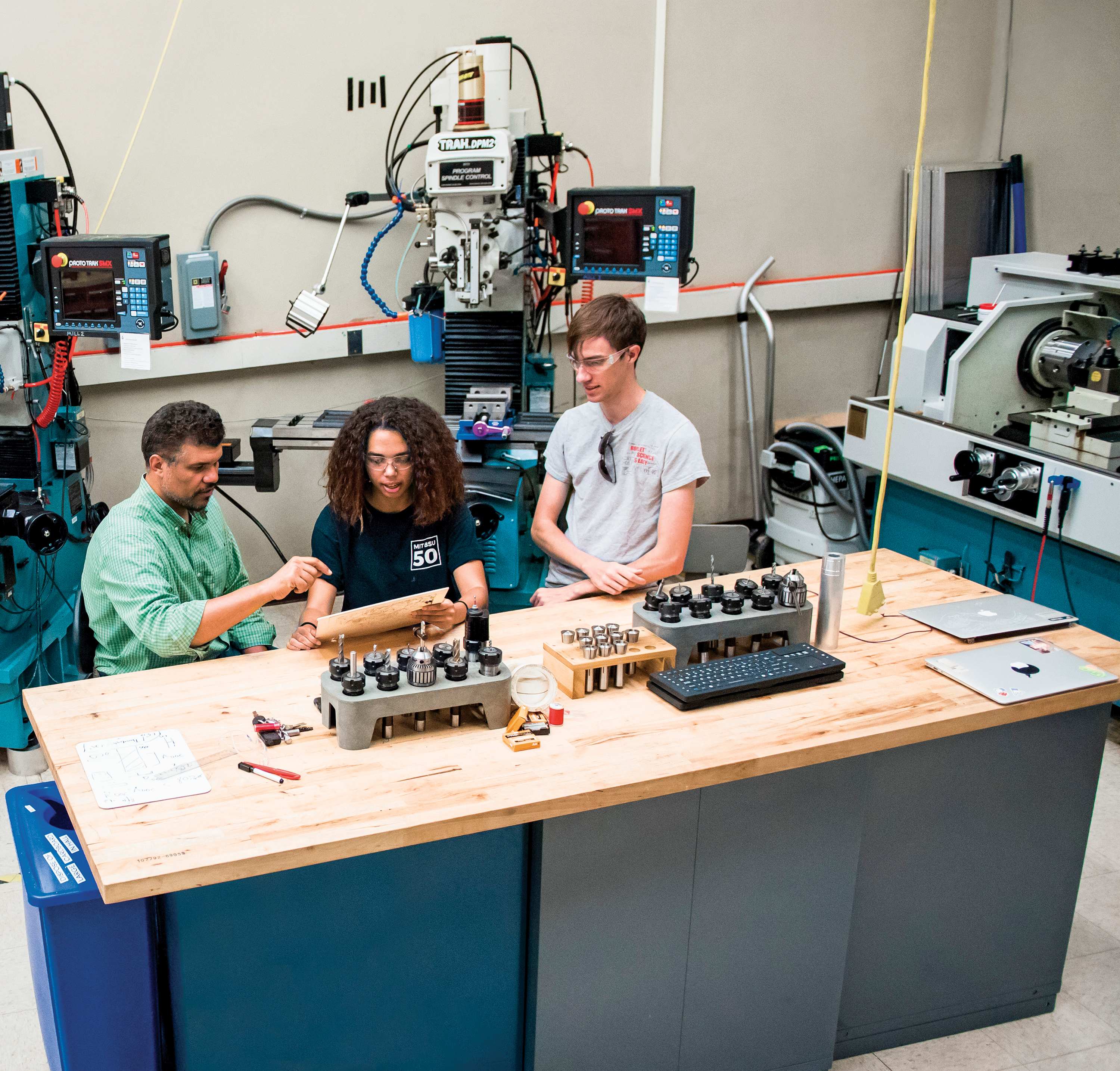 image of three people working in a makerspace