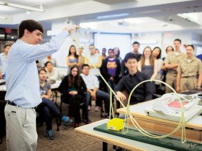 "MITx Digital Learning Fellow and Department of Physics lecturer Jolyon Bloomfield conducts a demonstration for students in 8.01 Classical Mechanics. The course runs on a ""TEAL+x"" model that delivers much of its core content online, maximizing time for in-class interactivity. Photo: Ben Bocko"