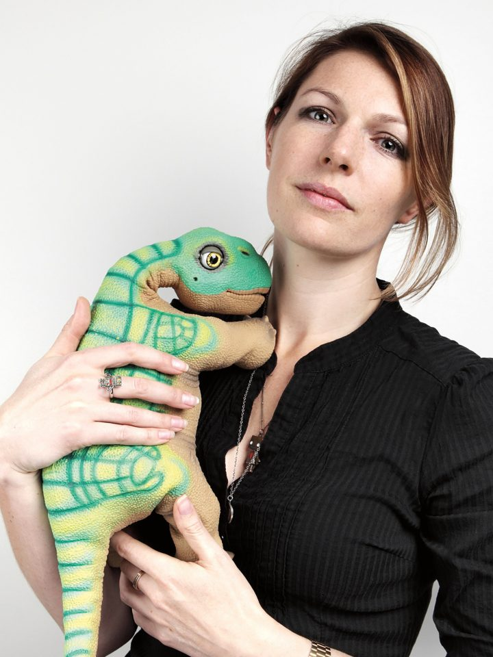 Media Lab researcher Kate Darling with one of the four robotic pet dinosaurs that live in her apartment. Photo: Flavia Schaub