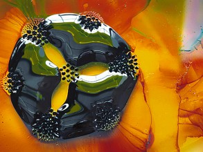 A 3-cm drop of ferrofluid on a glass slide. A slip of yellow paper sits below the slide and a set of seven small circular magnets under the paper affects the form of the drop. Image: Wikipedia/Frankel/CC-By-3.0