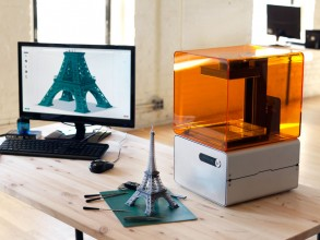 A replica of the Eiffel Tower and the Form 1 3D printer that created it.
