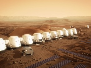 The nonprofit company Mars One plans to establish the first human settlement on Mars by 2025. Pictured is an artist's rendering of a series of habitats. Solar panels (in the foreground), would supply the colony's electricity, while a system to extract water from the soil (in the background) would supply drinking water. Image: Courtesy of Bryan Versteeg/Mars One