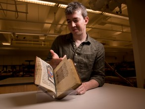 Professor Bahr was photographed in the Libraries' Wunsch Conservation Laboratory, with a 15th-century Book of Hours. The manuscript volume was donated to the Institute Archives and Special Collections by I. Austin Kelly (MIT 1926). Photo: Bryce Vickmark