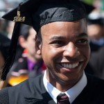 Photo of a smiling graduate at MIT's 2014 Commencement