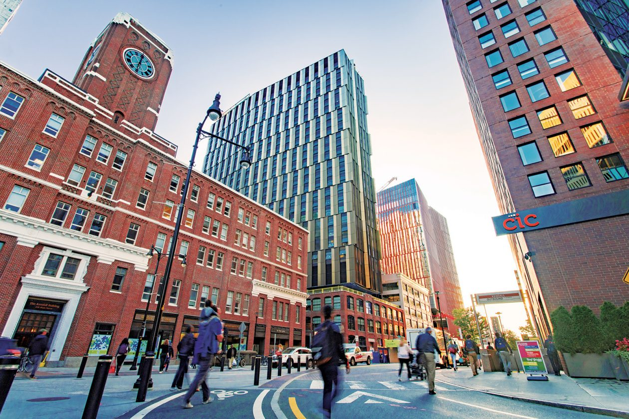The view down Main Street showcases the transformation of Kendall Square. Building E37, a new 29-story graduate residence, is at center.