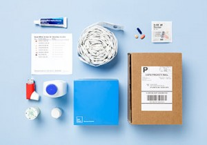 Every two weeks, PillPack customers receive a personalized roll of pre-sorted medications, along with a recyclable dispenser and any other medications that cannot be placed into packets. Image: PillPack