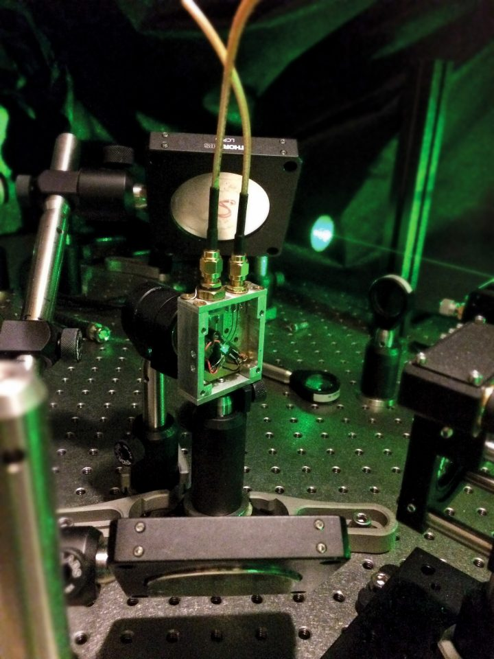 Paola Cappellaro experiments with a diamond chip containing qubits, shown at the center of this apparatus, seeking ways to address errors in quantum computing. Photo: Courtesy of Quantum Engineering Group