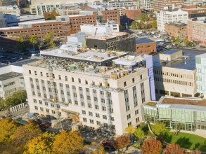 The Morris and Sophie Chang Building (foreground left) borders the vibrant Kendall Square technology hub. Photo: Christopher Harting with Above Summit