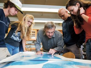 Professor Grove examines a map of the Martian landscape with students, from left, Kai Masterson, Megan Guenther, Anmol Maini, and Ulyana Piterbarg. PHOTO: SARAH BASTILLE