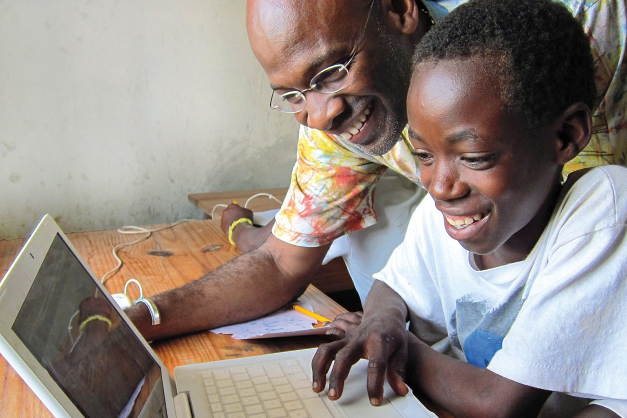 DeGraff works with a Haitian student.