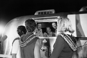 Apollo 11 astronauts, still in their quarantine van, are greeted by their wives upon arrival at Ellington Air Force Base on July 27, 1969. Image: NASA