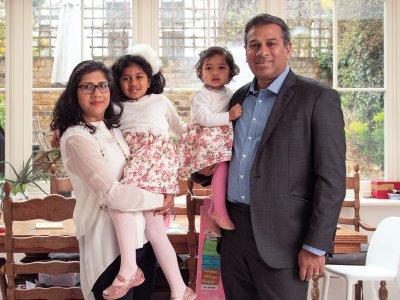Pop Sriram and Raj Venkataramani at home with their daughters. Photo: John Scrivener