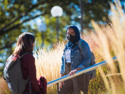 Students chat on campus in the fall. Photo: Gretchen Ertl