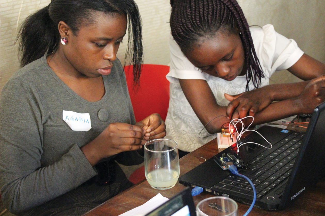Two women work on developing a smart weather monitoring system during a Mekatilili workshop in Kenya. Photo: Courtesy of Mekatilili