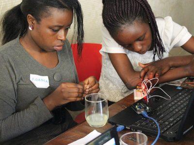 Two women work on developing a smart weather monitoring system during a Mekatilili workshop in Kenya. Photo: Courtesy of Mekatilili