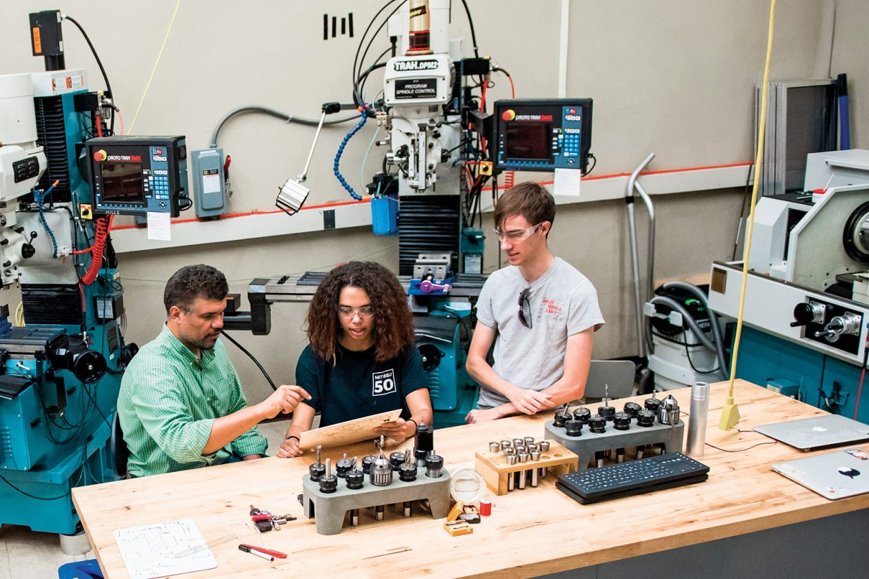 From left: Professor Martin Culpepper SM '97, PhD '00 works with Sabrina Hare '22 and Charlie Garcia '19 in The Deep, a makerspace in Building 37. Photo: Sarah Bastille
