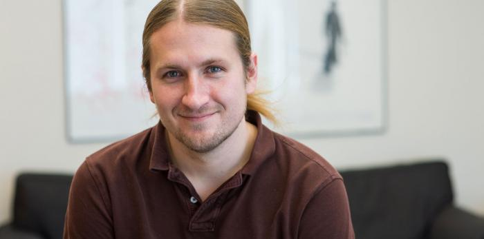 Jeremiah Johnson is the Firmenich Career Development Assistant Professor in MIT's Department of Chemistry. Image: Justin Knight