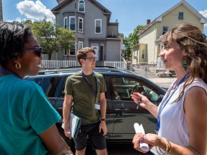 Focusing on three Boston-area communities experiencing interventions and six control communities, MIT researchers (including grad students Rob Call and Leigh Carroll, pictured center and at right in Roxbury) partnered this summer with community members (including Shannon Simpson, left) to field surveys on topics from health to violence and displacement. Photo: Peter Gumaskas