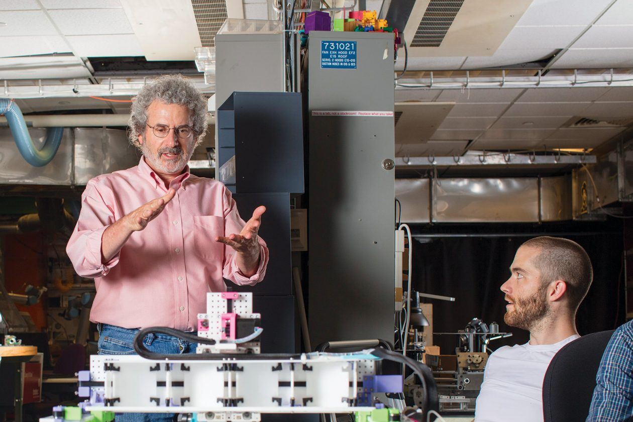 Neil Gershenfeld, left, works with graduate student Jake Read in the fab lab at MIT's Center for Bits and Atoms. Photo: M. Scott Brauer