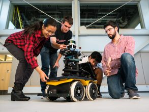 Yu Liang (Gloria) Fang, at left, says NEET's Autonomous Machines thread appeals to her because it involves hands-on projects. She is joined by Michael Everett, Albert Go, and Mitchell Guillaume. Photo: Lillie Paquette