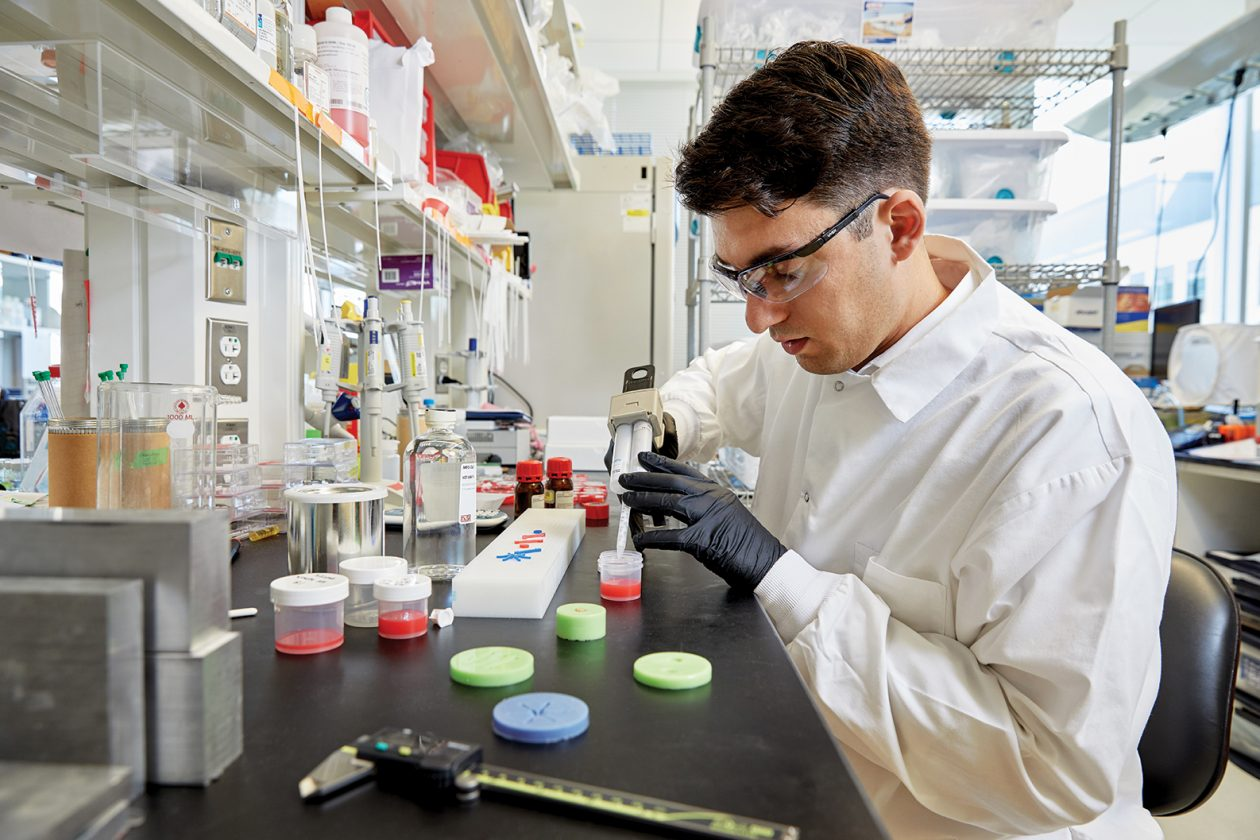 Gregory Ekchian works with oxygen-sensitive silicone in his lab at MIT. Photo: Ken Richardson