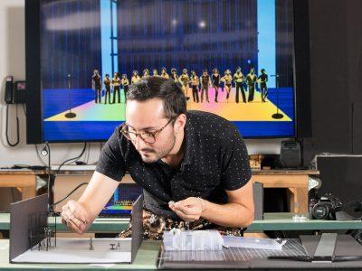 Architecture student Daniel Landez '21 works on a set design in W97, the new Theater Arts Building. Photo: M. Scott Brauer