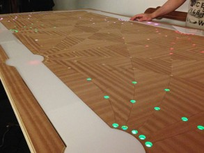 The Six Degrees Interactive Table glows when guests seated at the table have common interests. Image: MIT Mobile Media Lab