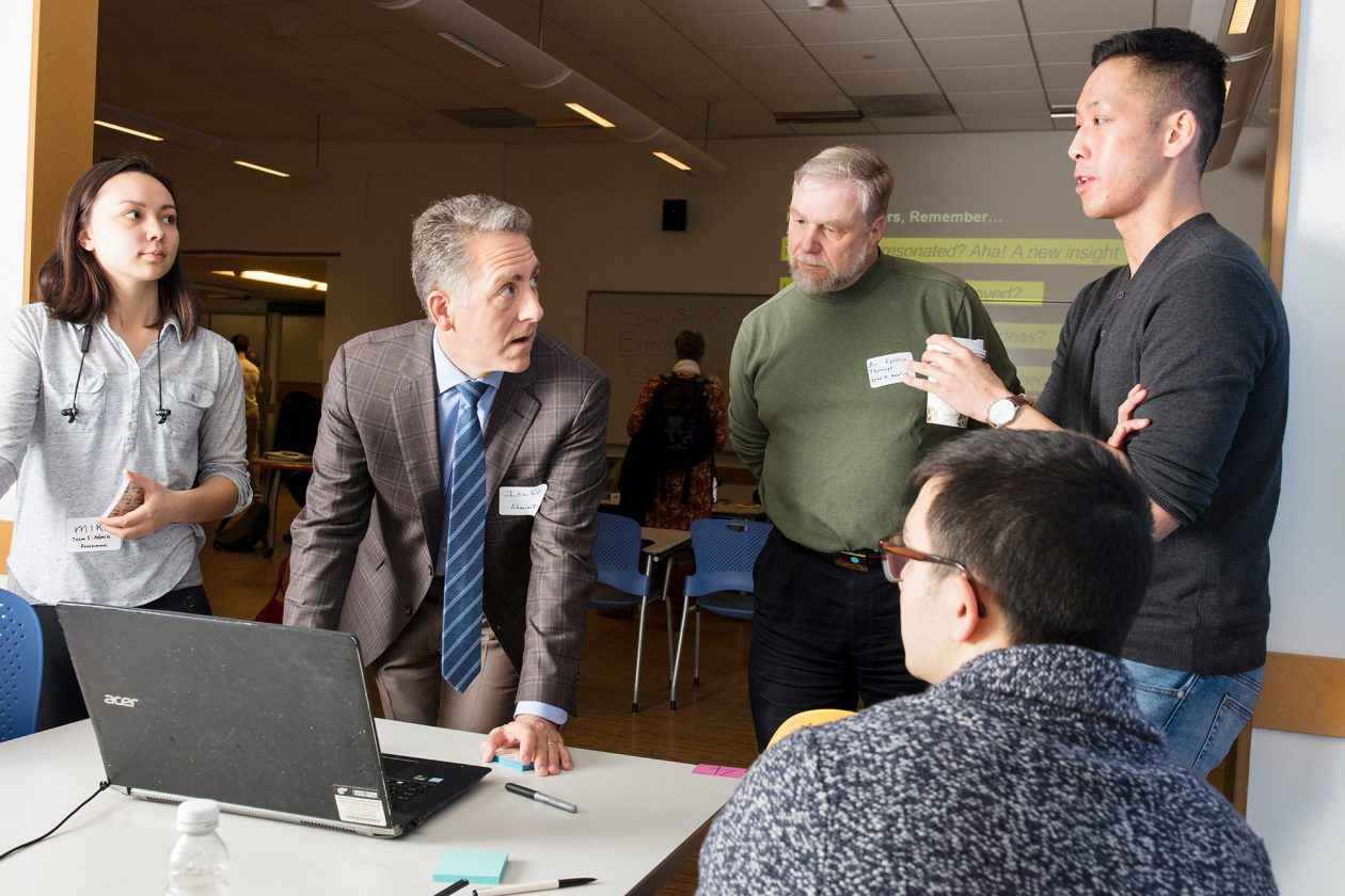 Ian Waitz, at computer, with students and mentors from the Designing the First Year at MIT class. Photo: M. Scott Brauer