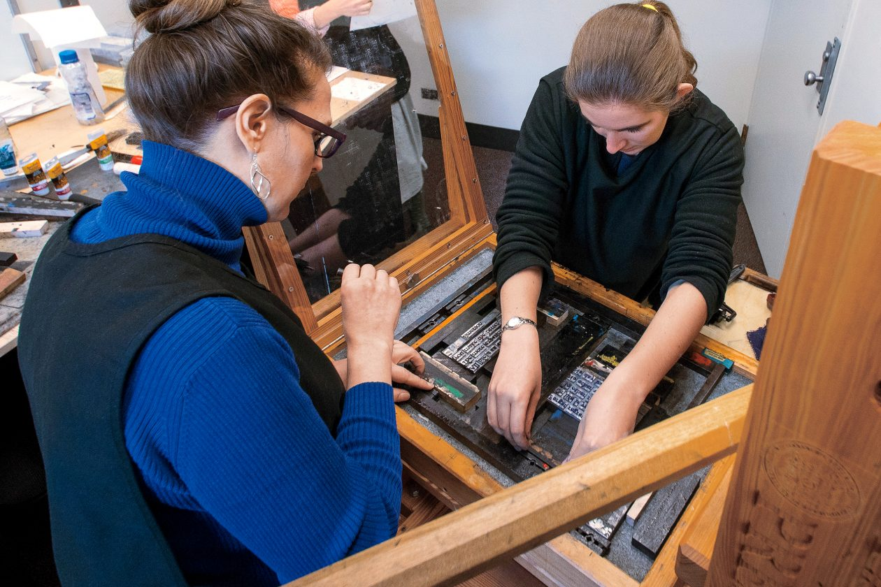 MIT Libraries staff learn the mechanics of the hand-set Beaver Press during open printing hours. Photo: Eric Keezer